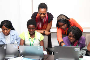 Girls learning to programme