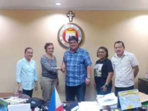 The director shaking hands with the Mayor of Silay