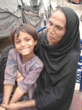 Samina and her daughter giving interview