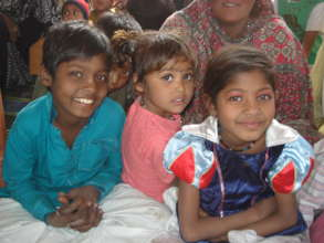 children excited to receive warm clothes