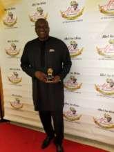 Mr Jonathan Kolo with his award.