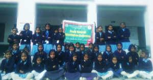 Distributed Woollen Dress to Needy Girl child
