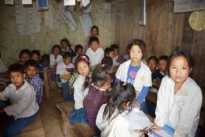 Children in Classroom without enough furniture