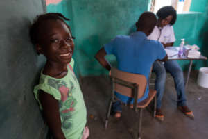 A young girl waits in line for a medical check-up