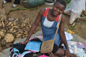 Remy, one of the girls supported, in the market