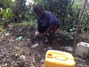 Maurice cleaning up his home garden