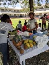 Madame Darlene preparing fresh fruit