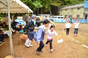 Children participating in sport event with locals