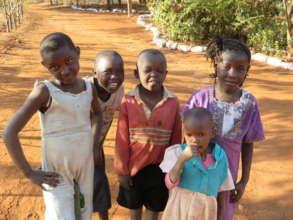 Wambua, siblings, cousins and friends