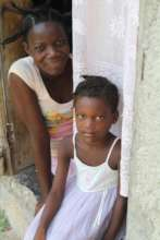 A woman and child with Consider Haiti