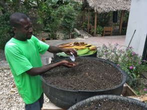 Sowing seeds in a tire garden, FONDAMA