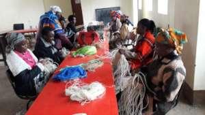 Jitegemee mothers learning basket-weaving.