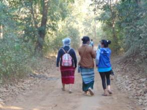 Outreach team walking to the next village