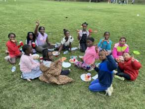 Congolese girls enjoy their pizza after soccer