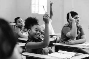 Girl raising her hand for quality education