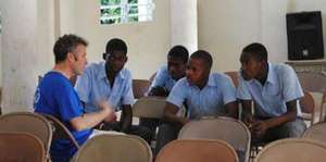 IESC volunteer with Haitian students