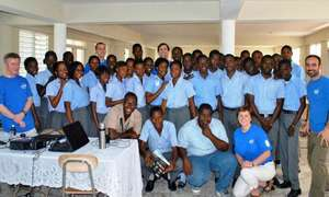 The IESC team with students and teachers in Haiti