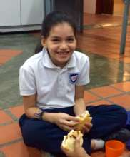 "A student eating an ""Arepa"" for breakfast"