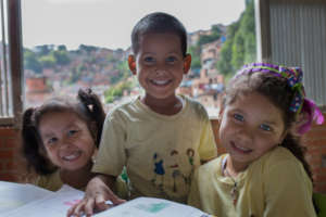 Kindergarten students - background: Petare slum
