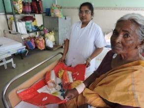 Elderly poor patient in hospital getting nutrition