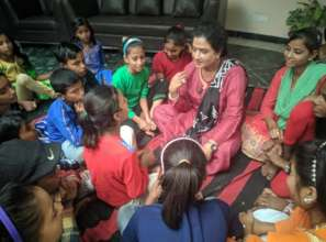 Chairperson Meera with the children of the project