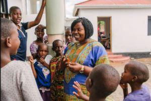Rhobi with girls at Mugumu Safe House