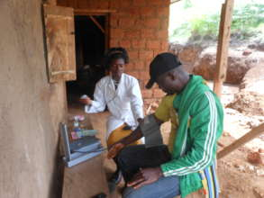 Lab Technician Jam attends to Patient at Ngemsibo