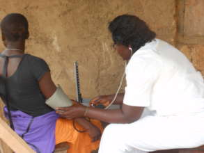 Midwife Lambe Consults Expecting Mother atNgemsibo