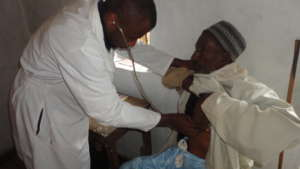Dr. Tembon Consulting a Patient at Ngemsibo