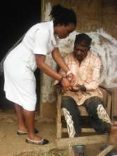 Nurse Che Consults elderly patient at Home