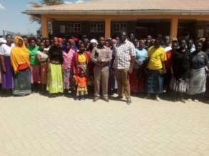 Dr. GK Mbuguah and Kenneth Branda with parents