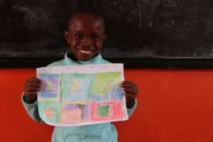 Proud of her drawing at the LLK Primary School