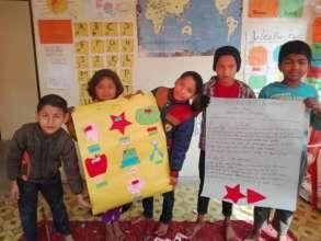 Children in Dhading showing off their art skills
