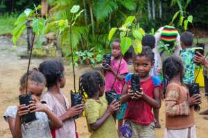 Kids at Club Atsatsaky planting fruit trees