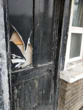 Broken door in a UK accommodation centre