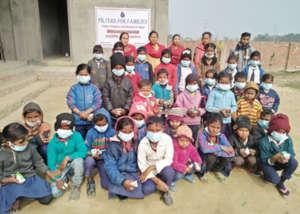 Young school children wearing masks after workshop