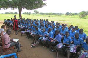 Ogwancan girls receiving sanitary pad kits in June