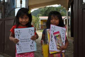 Britany & Aylin receiving their Adventure Journals
