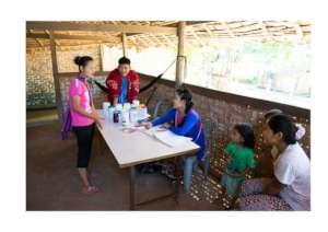 Health workers meet community members