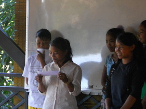 Some of the girls taking a turn to present