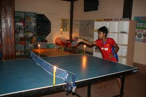 Ping pong by candlelight at Grace House Youth Club