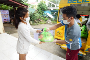 Handing out food packs in Leyte Region