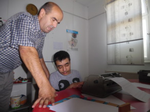 Teacher Shaip helping Sadik