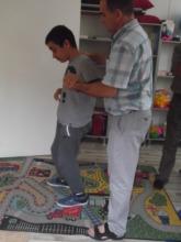 Sadik has difficulties walking