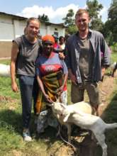 Kyaninga Dairy team with Mary and her goats