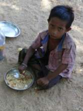 rescued children providing mid day meal