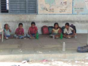 Migrated families Kids having mid day meal