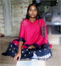 Madhumita* at her house while studying