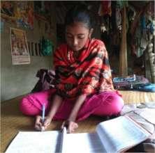 Engrossed in studies- Mitali* in her house