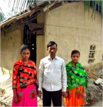 With Father & Sister before their small mud house